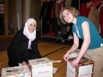 Lamya Sahraoui and Erin Rosekrans prepare boxes for donations to Women For Women and Chadwick House.
