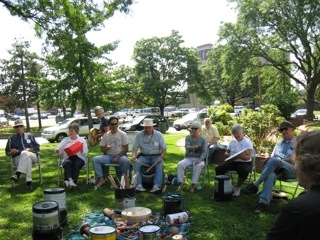 Rapha Community leads a drumming circle at Forman Park