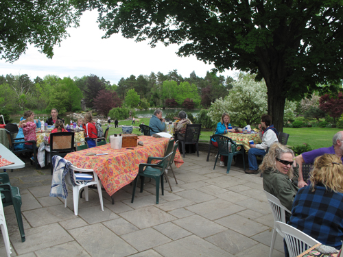 Several groups enjoying a picnic on the terrace
