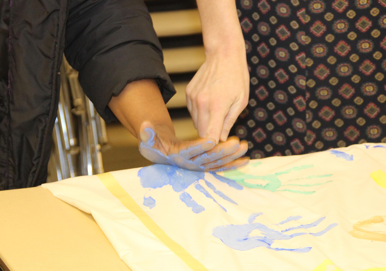 Making handprints for a banner