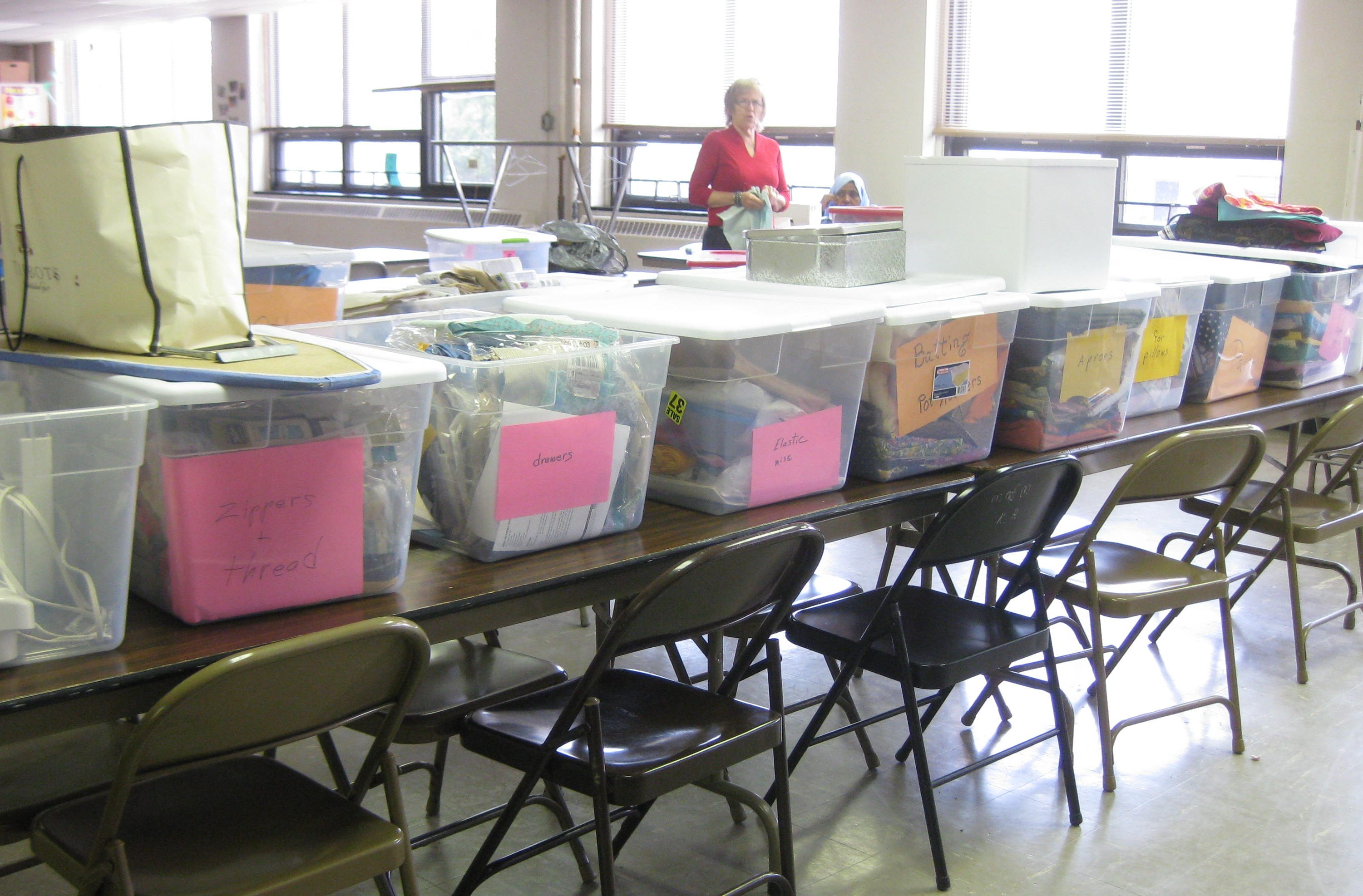 Sewing class - sorting donated supplies