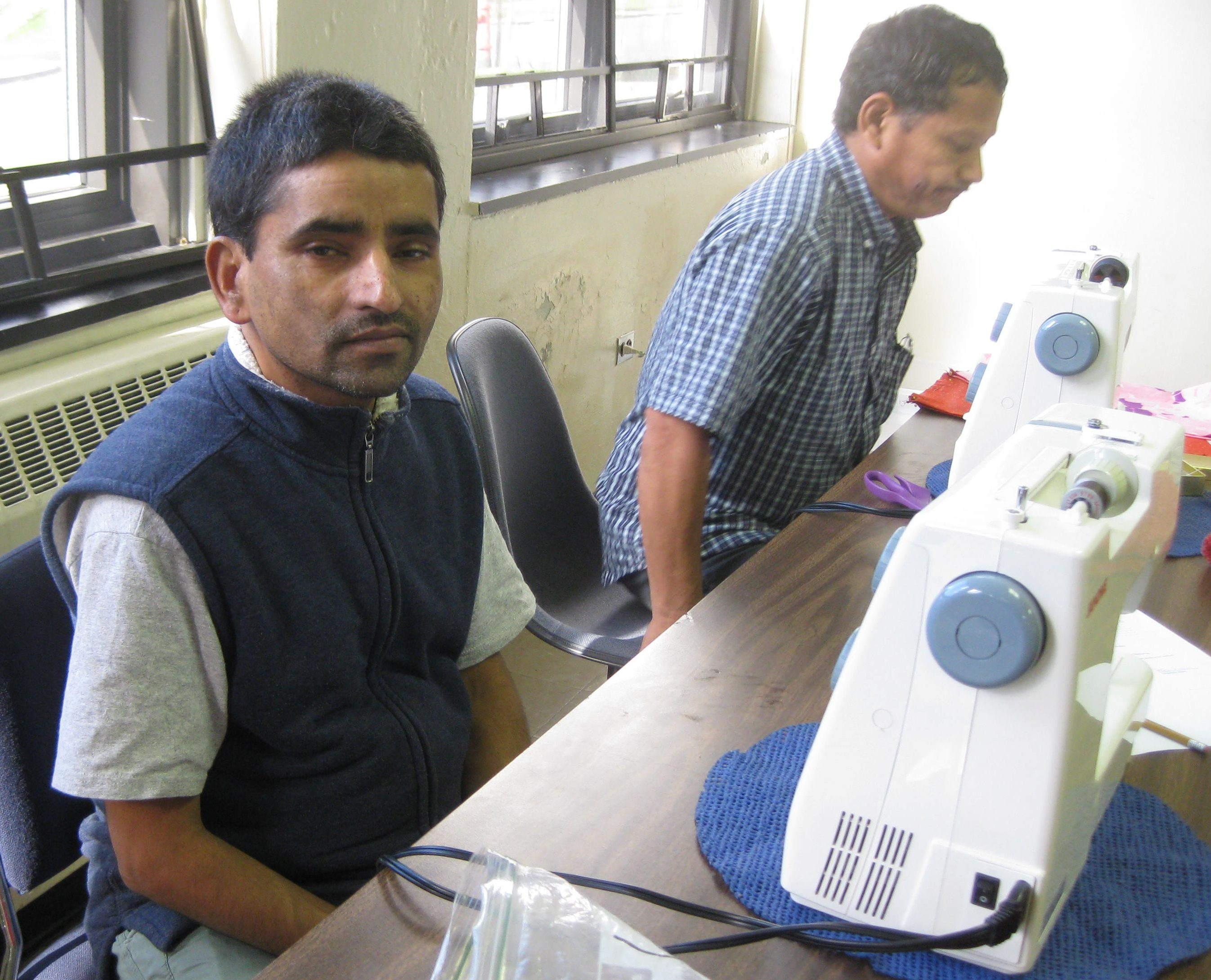 Sewing class - students check out the machines