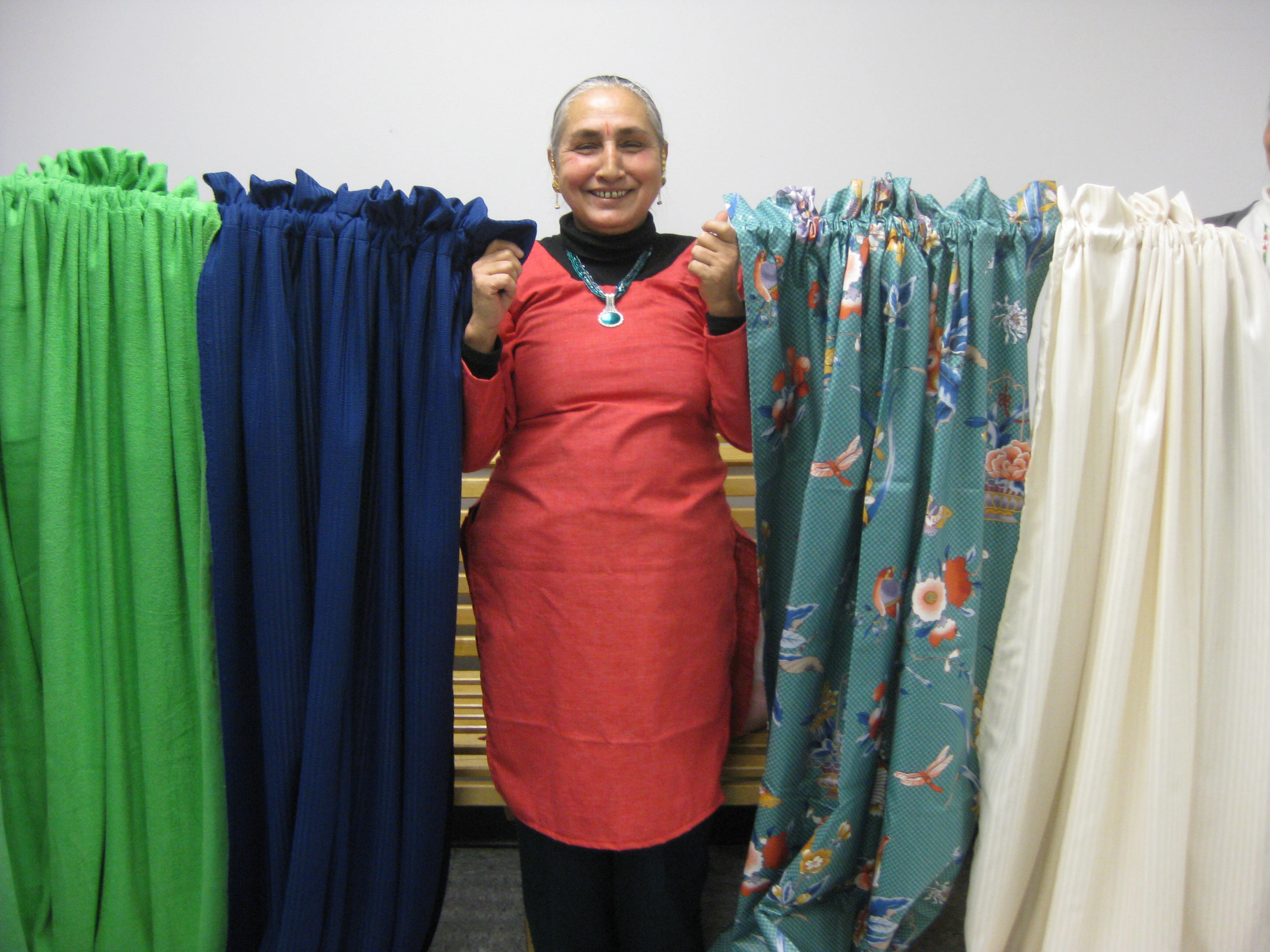 One sewing class graduate makes curtains for new arrivals