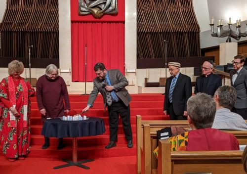 InterFaith Works Round Table of Faith Leaders - lighting candles
